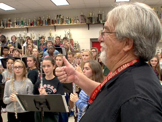 Jackson Memorial High School's iconic band director Bud McCormick gives his band a thumb.s up Wednesday.