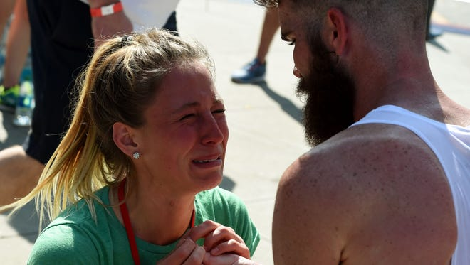 Brandon Birdsong proposes marriage to his girlfriend Brittni Hutton after he completed the US Men's Marathon Olympic Team Trials in Los Angeles on Feb. 13, 2016.
