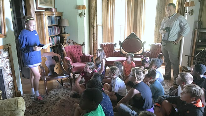 Hendy Elementary School student Alana Heath reads a Mark Twain-inspired essay to her classmates in the parlor of Quarry Farm, Twain's summer home.