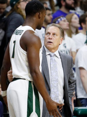 Michigan State coach Tom Izzo talks to guard Joshua Langford (1) during the second half of MSU's 80-76 win Saturday at Breslin Center.