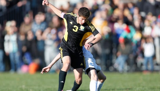 Hastings' Nate Constantine (3) works the ball during