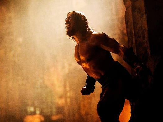 "Dwayne ""The Rock"" Johnson breaks through stone pillars in ""Hercules"" coming out July 25. The Rock admits there was some ""confusion"" with a rival film out in January called ""The Legend of Hercules"" starring Kellan Lutz. Here's a look at both films."