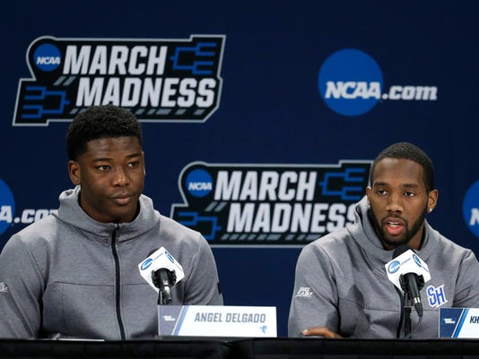 Seton Hall's Angel Delgado and Khadeen Carrington talk to the media during a news conference for an NCAA college basketball first round game Wednesday, March 14, 2018, in Wichita, Kan. (AP Photo/Charlie Riedel)