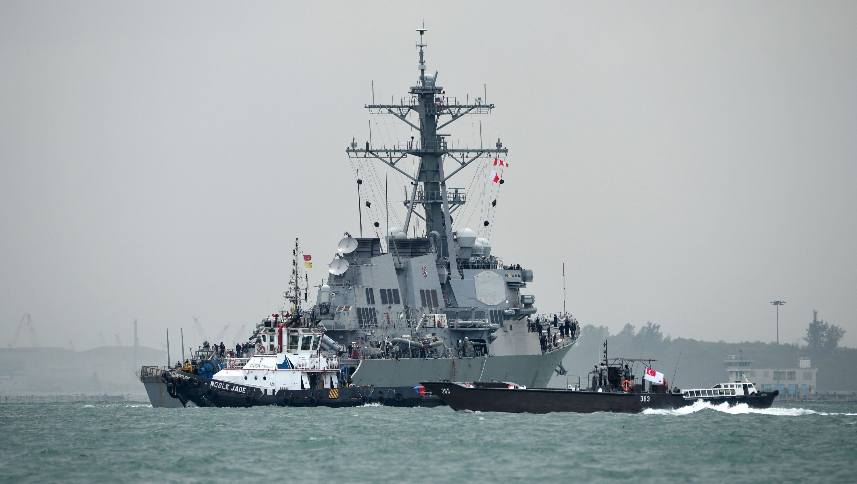 USS John S. McCain arrives at Singapore naval base after collision leaves 10 missing