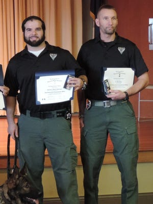 Kenton County Sheriff's Deputy Miguel Rodriguez and Ludlow Police Lt. Bart Beck (along with K-9 Santo), pictured in a Nov. 2014 Enquirer photo from their receipt of commendation medals from the Simon Kenton chapter of the Sons of the American Revolution.
