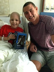 Benjamin Burke (left). Benjamin's hero, Anthony Rizzo, Chicago baseball World Champion and Hodgkin lymphoma Survivor (right)