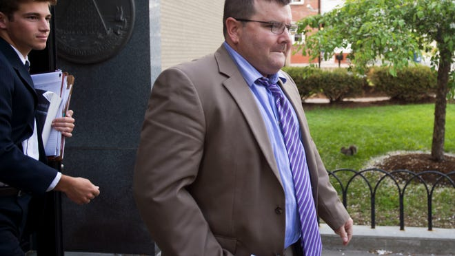 Former Colchester police detective Tyler Kinney, 39, leaves federal court in Burlington after pleading guilty in May 2015 to heroin distribution, firearms trafficking and theft.