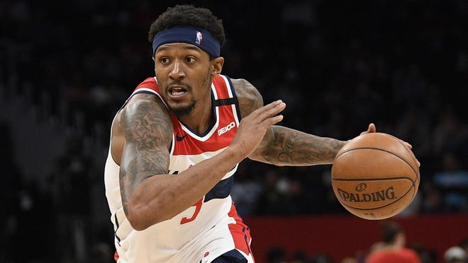 Washington Wizards guard Bradley Beal (3) dribbles the ball against Miami Heat guard Andre Iguodala (28) during the second half of an NBA basketball game, Sunday, March 8, 2020, in Washington. The Heat won 100-89.