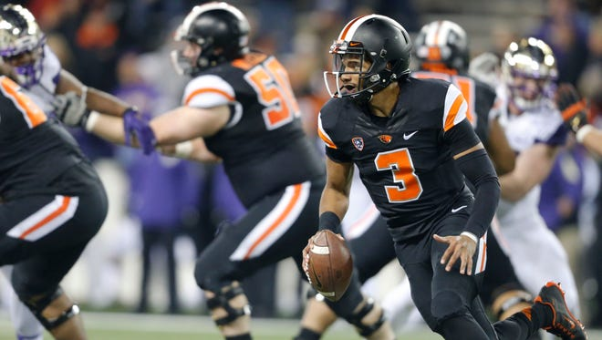 Oregon State quarterback Marcus McMaryion looks for running room against the Washington defense during the second half of an NCAA college football game, in Corvallis, Ore., on Saturday, Nov. 21, 2015. Washington won 52-7. (AP Photo/Timothy J. Gonzalez)