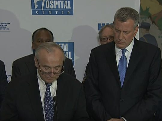New York Police Commissioner William Bratton and New