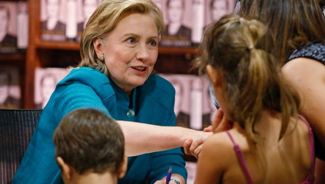 """Former Secretary of State Hillary Clinton greets fans at a book signing for her new book """"Hard Choices""""  at the Tattered Cover Book store in Denver on June 23, 2014."""