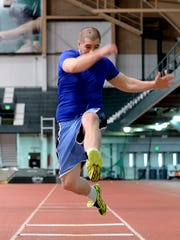 Justin Caine trains March 29 at Jenison Field House.
