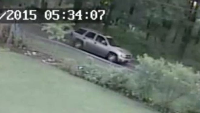 This screenshot is taken from a video released by the Clarsktown police department shows a gold SUV believed to be involved in a hit-and-run in Nanuet.