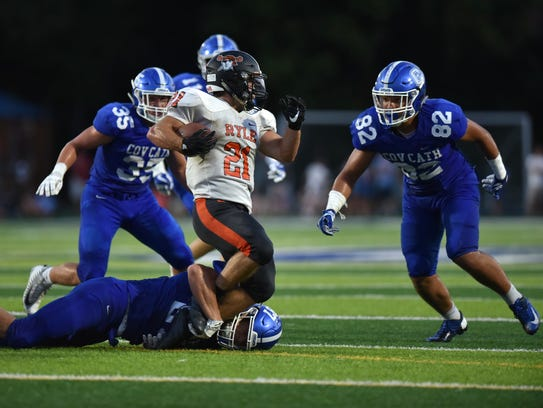 Ryle's Jacob Chisholm is tackled by Covington Catholic's