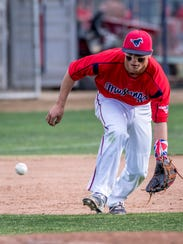 Tulare Western's David Alcantar goes after  hit ball