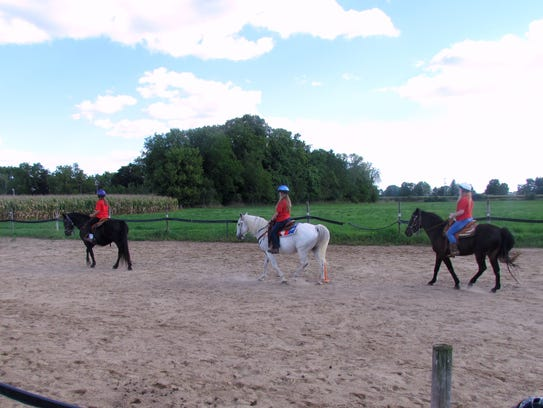 The first three girls in line perform a quadrille they