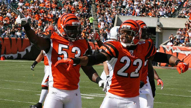Then-Cincinnati Bengals linebacker Thomas Howard (53) and cornerback Nate Clements (22) celebrate recovering a fumble against the Indianapolis Colts in a 2011 game at Cincinnati.