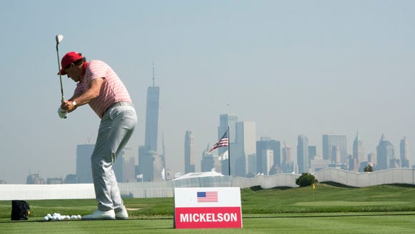 Phil Mickelson practices at Liberty National Golf Club