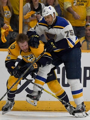 Predators defenseman Matt Irwin (52) and Blues right wing Ryan Reaves (75) get up from the ice during the second period of Game 3 on Sunday, April 30, 2017, in Nashville, Tenn.