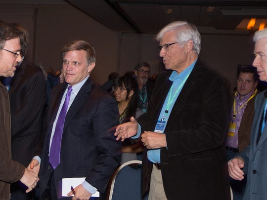Wall Street Journal columnist Bret Stephens shakes hands with historian Douglas Brinkley as author Geoff Cowan and former California Gov. Gray Davis look on at the January Rancho Mirage Writers Festival.