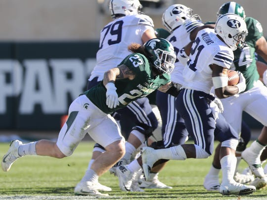 Michigan State Spartans Chris Frey tackles BYU Cougars Jamaal Williams.