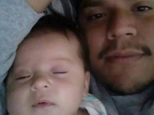 Leonardo Martinez-Hernandez, 25, of Salem, with his daughter.