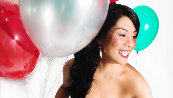 """New York singer-songwriter Elizabeth Chan harbors a dream of writing a Christmas standard. Her """"Fa La La"""" has made USA TODAY's Adult Contemporary airplay chart this year."""