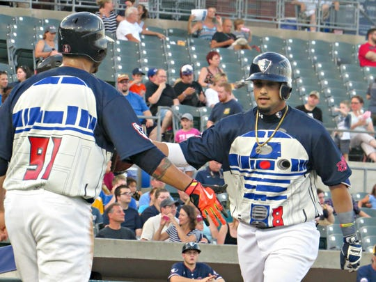 The Somerset Patriots' David Vidal (right) celebrates his 20th homer of the season with teammate Aharon Eggleston on Monday.