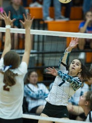 Onate'a Kristiana Romero watches her spike sail over