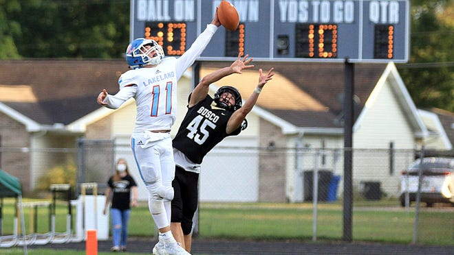 Lakeland safety Colton Isaacs deflects a pass near the goal line late in the first quarter on Friday night.