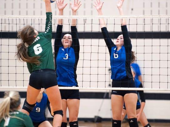 Harper Creek's Katie Wade and Kim Kusler work on defense