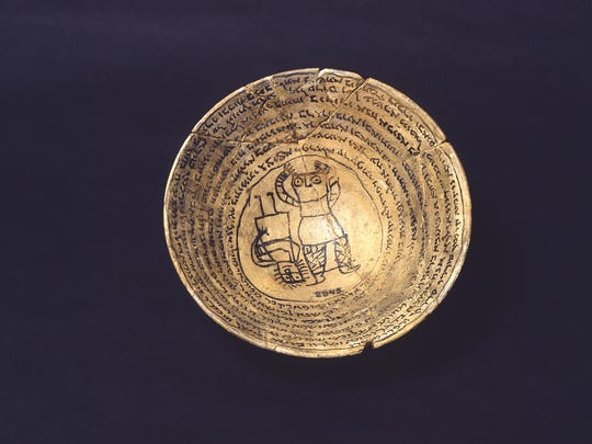 This bowl is ceramic, with ink decoration, circa 300–700
