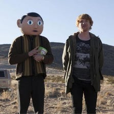 "Maggie Gyllenhaal, MIchael Fassbender and Domhnall Gleeson star in a scene from ""Frank."""