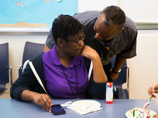Vincent Keeys, president of the Collier County chapter of the NAACP, thanks Noelle Merveilleux, 14, a student at Golden Gate Middle School, for reading  Tuesday, Feb. 7, 2017, at the Golden Gate Public Library in Golden Gate. Collier County youth services librarian Kathy Hemmat worked with the local chapter of the NAACP to do a series of dramatic readings focusing on the Underground Railroad.