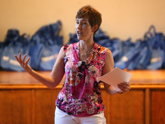 Community Soup Kitchen Community Educator Julie Hess speaks during a free 'Growing Healthy Kids' program for more than 100 local youngsters  thanks to a $42,000 grant from the Walmart Foundation held at St. Peter's Episcopal Church. August 3, 2016, Morristown, NJ