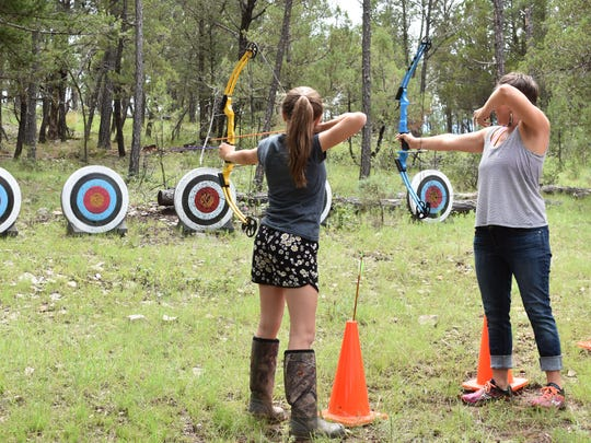 About 45 women and girls attended the third annual Women in the Outdoors retreat at Camp Tall Pines in Mayhill.
