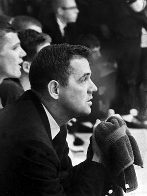 January 25, 1963 - Kingsbury coach Bill Todd was a picture of concentration on Jan. 25, 1963, as he saw an 11-point lead dwindle to four as the final buzzer sounded, hanging on for a 64-60 Prep League basketball victory over Frayser in the battle of division leaders that marked the completion of the inter-divisional round. Mike Butler (not pictured) scored 25 points for the Falcons, who won their 13th straight game to  remain the only undefeated team in the league and atop the Eastern Division. Frayser remained ahead in the Western Division.