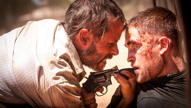 "Guy Pearce and Robert Pattinson in ""The Rover."""