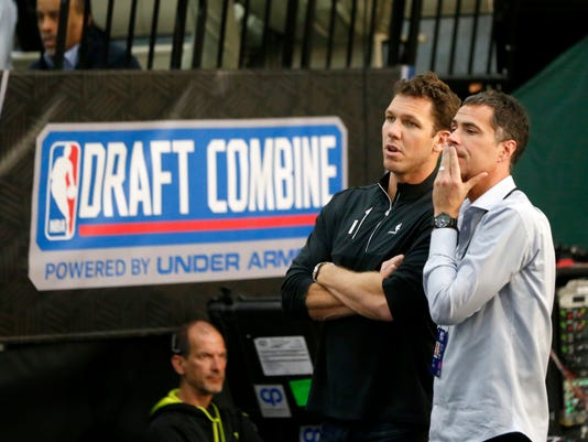 Los Angeles Lakers head coach Luke Walton, left and General Manager Rob Pelinka watch prospects participate in the NBA draft basketball combine Friday, May 12, 2017, in Chicago. (AP Photo/Charles Rex Arbogast)