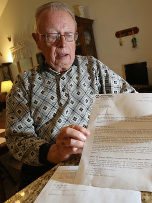 Kenneth C. Brunner holds up a letter that was addressed to his wife from the Department of Veterans Affairs and sent to his Madison home, stating that he had died and she would receive a check for the month that he passed. Brunner, an 81-year-old Army veteran, says he tried to call the agency on Tuesday to deliver a few choice words, but the office was closed for Veterans Day.