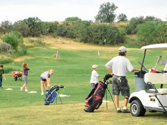 Danny Udero/Sun-News   Youth golfers get instruction on hitting with irons during the first day of session one in the Drew Hunter Junior Golf Camp.