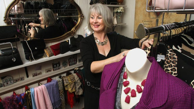 Judy Hagan carries an eclectic mix of women and men's fashion accessories at Snooty Judy's Boutique in Genoa Township.