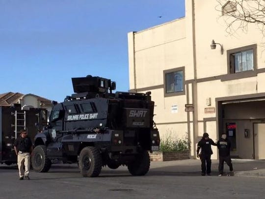 Members of the Salinas Police SWAT team served an arrest warrant in Chinatown on Thursday morning.