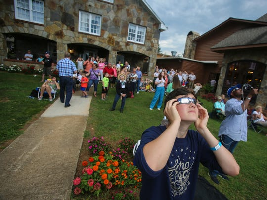 Seacrest Country Day School 10th-grader Alexandre Chapelle, 15, worries as clouds pass over the sun, obstructing the view, just minutes before totality in Dillard, Ga., on Monday, Aug. 21, 2017.