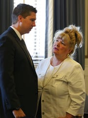 Ray Tensing speaks with his step-mom, Amy Tensing, prior to the third day of testimony in his retrial in Hamilton County Common Pleas Judge Leslie Ghiz's courtroom Monday, June 12, 2017.
