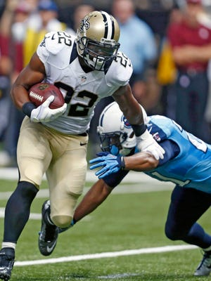 New Orleans Saints running back Mark Ingram (left) rushes against Tennessee Titans free safety George Wilson in a preseason game Friday. Through two preseason games, Ingram has carried 13 times for 102 yards and had a 22-yard scoring run.