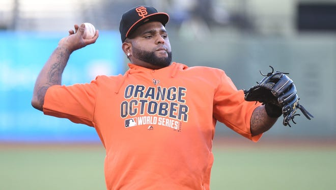 Giants third baseman Pablo Sandoval (48) throws a baseball during workouts on Thursday at AT&T Park.