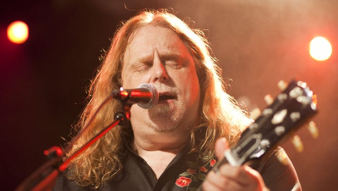 Warren Haynes performs on stage at the P.C. Richard & Son Theater in New York in 2011.