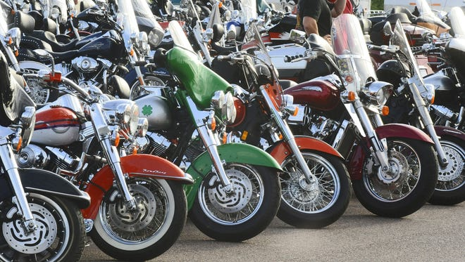 Bikers and lookers gathered for the sights, music and food at J&L Harley Davidson Friday night for the Bike Show part of this year's Hot Harley Nights. Colorful bikes fill the parking lot at J&L Harley-Davidson for the bike show.