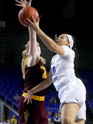 MTSU's Alex Johnson (00) goes up for a shot as Arizona State's Quinn Dornstauder Sara Hattis (44) guards Johnson, on Tuesday, Dec. 13, 2016, at MTSU.